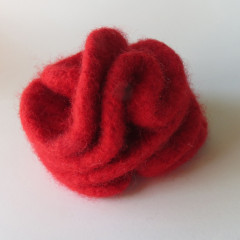 hand knitted red rose