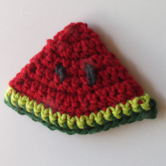 crocheted red watermelon slice