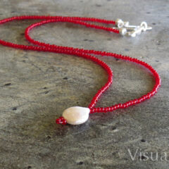Pearl Droplet Necklace on Red